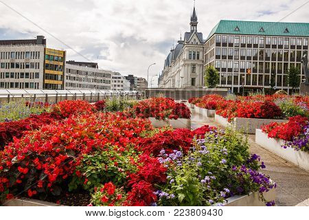 Oslo, Norway-August 14, 2014 - Street with buidings, people and flowers in Norwegian capital.