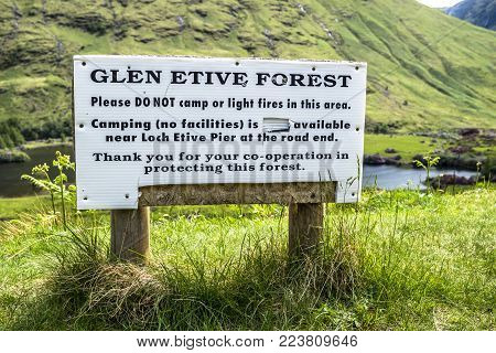 GLEN ETIVE , SCOTLAND - MAY 30 2017 : Sign warning to protect the forest