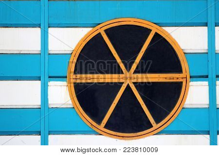 Colorful Round Window On Wooden Surface.