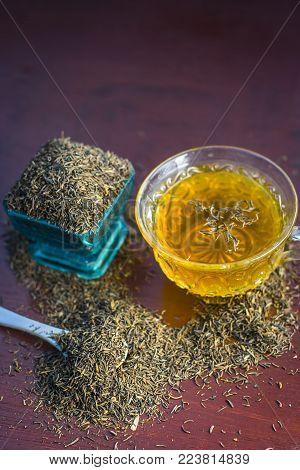 Black Cumin Seeds,shah Jerra,nigella Sativa  And Its Tea On Brown Wooden Surface.;