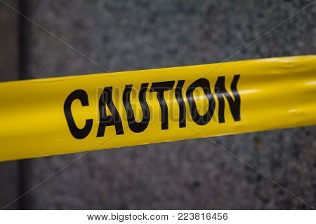 Police caution sign tape in city, close up