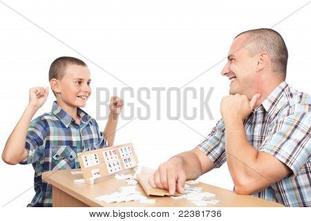 Father and son playing rummy isolated on white background poster