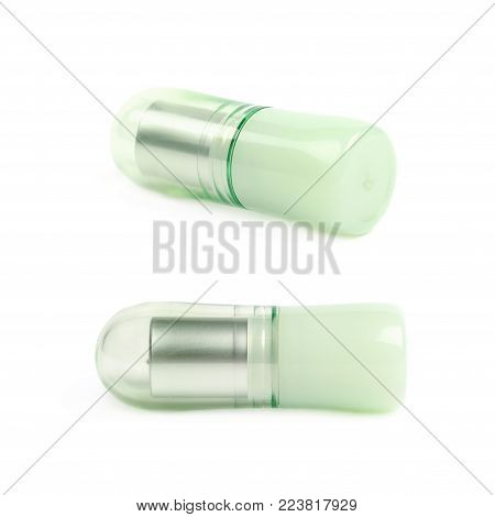 Vaseline lip balm stick pomade lying on its side, composition isolated over the white background, set of two different foreshortenings