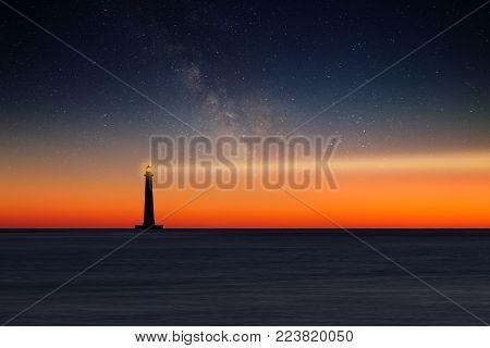 Lighthouse against night sky. Morris Island Lighthouse, South Carolina, USA