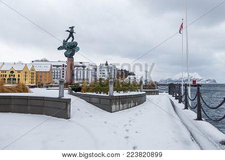 Ferry In The Port Of Alesund. Winter Landscape.