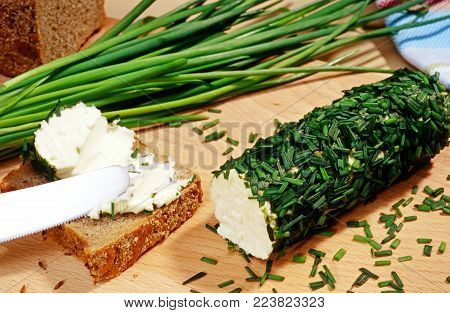 cream cheese rolled in chive , bread slice and chive