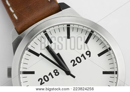 Analog watch with conceptual visualization of the turn of the year 2018 2019