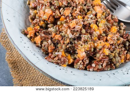 Red rice, lentils and butternut squash with carrot and quinoa in a herby dressing, healthy clean eating concept