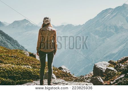 Woman alone standing in mountains wander landscape Travel Lifestyle adventure concept active summer vacations outdoor harmony with nature emotions