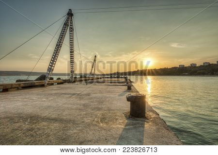 Sunset over Varna, with pylon for wake board