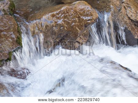 water from a spring in the mountains .