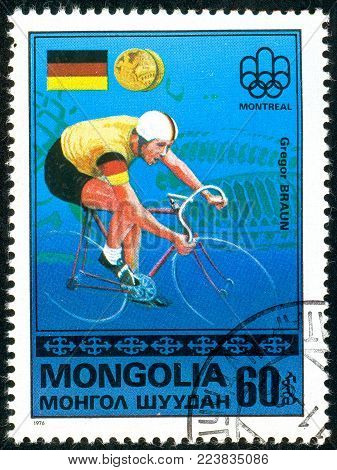 Ukraine - circa 2018: A postage stamp printed in Mongolia show cyclist Gregor Braun and German flag. Series: Medalists from Montreal. Circa 1976
