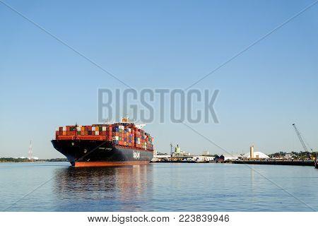 SAVANNAH, GEORGIA, USA - OCTOBER 31, 2017: Huge container ship Hapag-Lloyd near the port in Savannah, GA, USA
