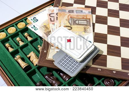 Gamble composition with cards and chess and money