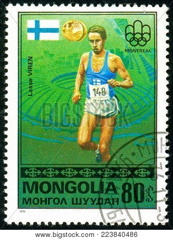 Ukraine - circa 2018: A postage stamp printed in Mongolia show runner Lasse Viren and Finnish flag. Series: Medalists from Montreal. Circa 1976