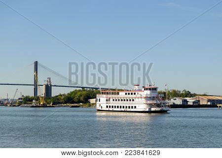 SAVANNAH, GEORGIA, USA - OCTOBER 31, 2017: Savannah, riverboat Georgia Queen on excursion by the river.