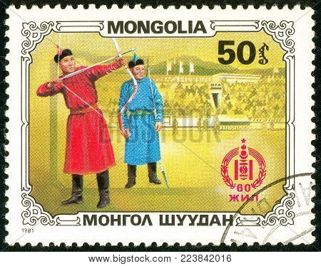 Ukraine - circa 2018: A postage stamp printed in Mongolia show Archers in a Mongolian national costume. Archery is the national sport of Mongolia. Series: Sport and culture. Circa 1981.