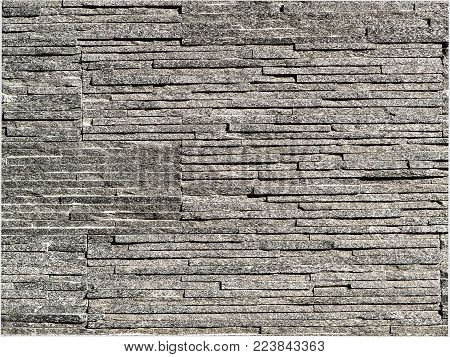 Stacked grey thin slate bricks background photograph. Uneven and rough texture. Modern, natural luxury style. Thin slate bricks, authentic photograph shot outdoors with natural light.