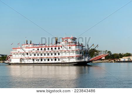 SAVANNAH, GEORGIA, USA - OCTOBER 31, 2017: Savannah riverboat Georgia Queen on excursion by the river.