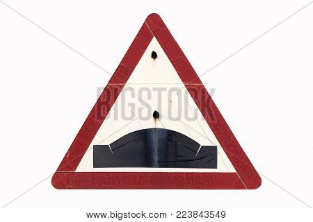 Old dirty rusty triangular red border road sign 'Hump' isolated on white.