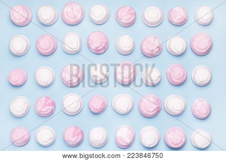 Pink and White Tasty Marshmallows on Blue Background Flat Lay Top View Background Texture of Colorful Marshmallows Food Concept Horizontal