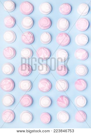 Pink and White Tasty Marshmallows on Blue Background Flat Lay Top View Background Texture of Colorful Marshmallows Food Concept Vertical