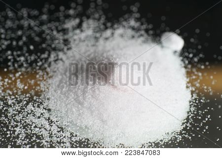 Citric acid in detail as a powder poster
