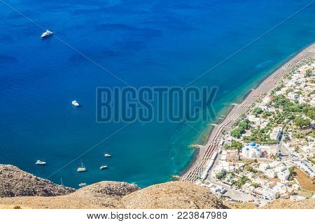 Perissa beach, Santorini island, Greece. Beautiful aerial view of Perisa village from Ancient Thira
