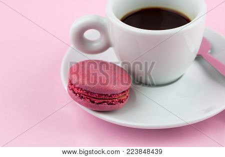 Cappuccino Espresso Coffee On A Pink Background With French Macaroons Or Macaron Cookies