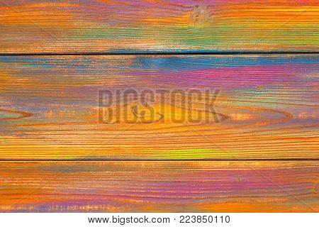 Bright, colorful mottled background. Wooden background painted colors. The texture of the wood. Blank background. Free space. background colored wood