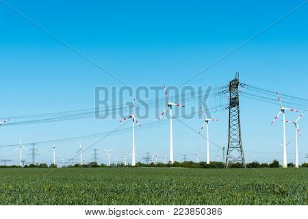 Wind Power Plants And Power Transmission Lines Seen In Rural Germany