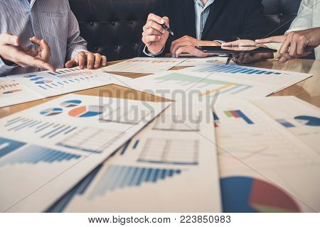 Meeting and greeting, Business team colleagues discussing working analysis with financial data and marketing growth report graph in team, Meeting Talking Brainstorming Communication Concept.