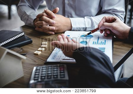 Real estate broker agent being analysis and making the decision a home estate loan to customer to signing contract documents for realty purchase, Bank employees recommend mortgage loan approval. poster