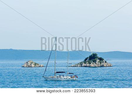 Trogir, Croatia - 8 may 2016: boat cruising past Celic island on the croatian coast