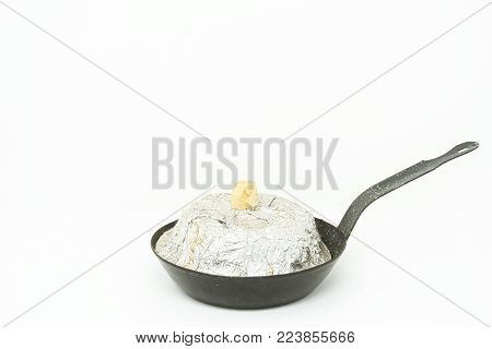 Small black frying pan isolated on white.