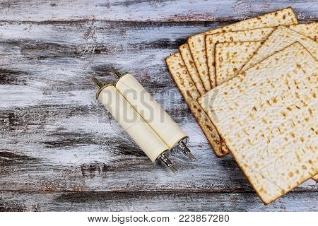 Pesah celebration concept jewish Passover holiday . Traditional book with text in hebrew: Passover Haggadah Passover Torah scroll during