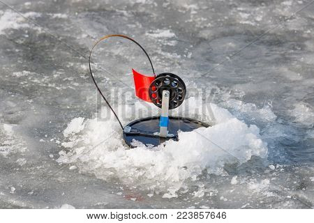 Fishing tackle for winter fishing on ice of a frozen lake