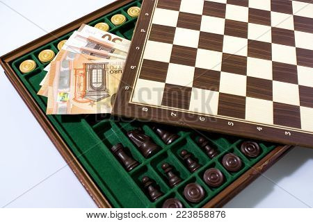 Gamble composition with chessboard, chess and money