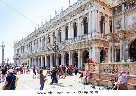 VENICE, ITALY - May 18, 2017 : street view of old buildings in Venice on May 18, 2017. its entirety is listed as a World Heritage Site, along with its lagoon