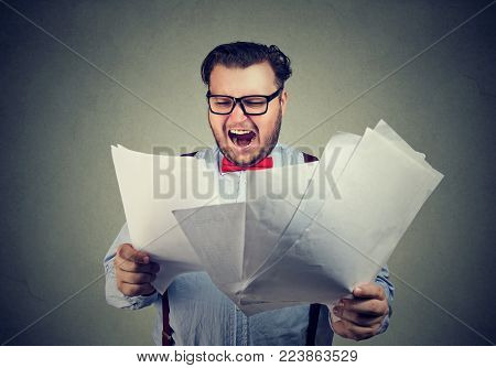 Chubby businessman exploring papers of contract and screaming in stress.