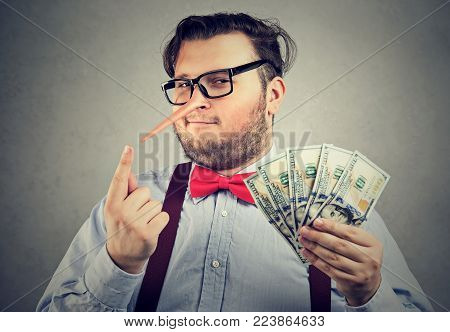 Obese formal man with long nose having money after conducting fraud.