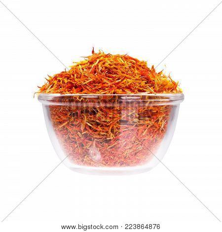 Safron stamens in saucepan on white background. High resolution photo.