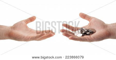 Russian ruble coins in the palm of a person who hands over to another hand isolated