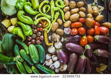 Vegetables on wood. Organic vegetables in rustic setting. Fresh food. Healthy veggies