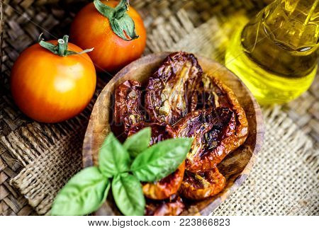 Vegetarian food. Sun dried tomatoes with herbs and garlic. Italian food vegetables
