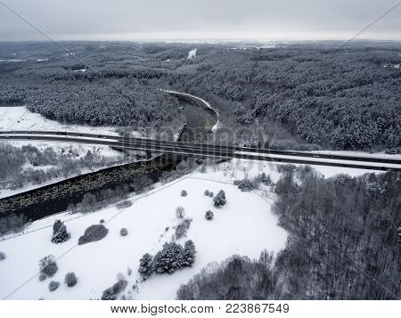 Vilnius, Lithuania: aerial top view of Neris river, surrounding forests and Gariunai road in winter