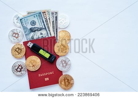 Red passport white background, identity confirmation. Memory card USB stick purse. US dollars USD, metal coins gold silver bitcoin, crypto currency customer identification. Security code cold wallet.