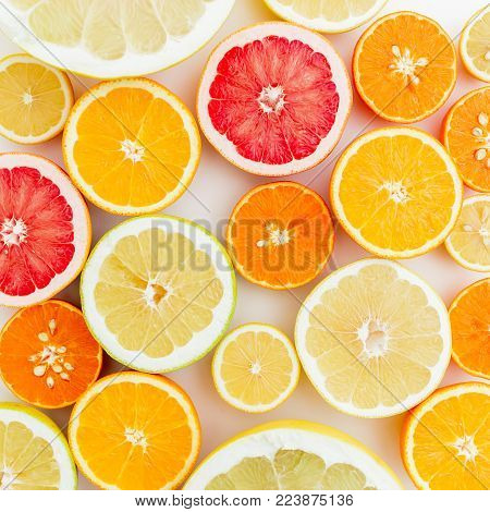 Lemon, orange, grapefruit, sweetie and pomelo on white background. Flat lay, top view. Food pattern