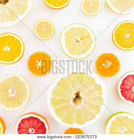 Citrus fruits pattern made of lemon, orange, grapefruit, sweetie and pomelo on white background. Flat lay, top view.