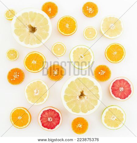 Lemon, orange, mandarin, grapefruit, sweetie and pomelo on white background. Flat lay, top view. Fruit background